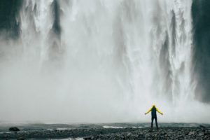 Person by waterfall