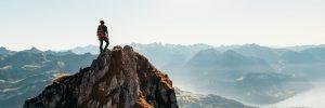 Man climbing a scenic mountain