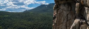 Woman rockclimbing in a national forest